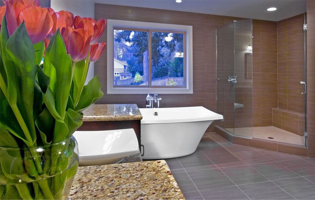Contemporary Master Bathroom with Vessel sink, Shower, frameless showerdoor, Wall Tiles, Complex marble counters, can lights