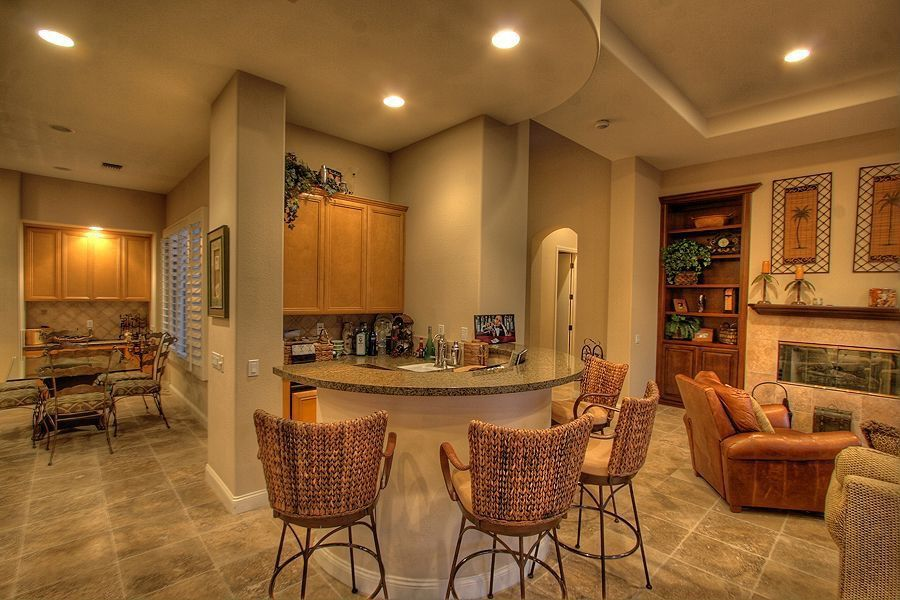 Eclectic Bar with full backsplash, Simple granite counters, stone tile floors, Breakfast nook, Framed Partial Panel