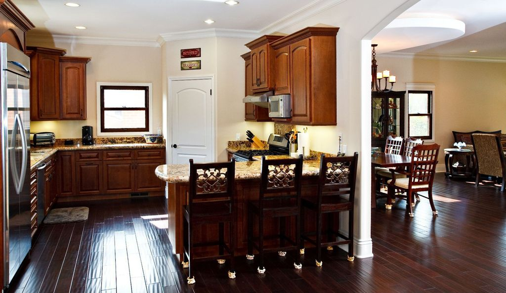 Traditional Kitchen with Pendant light, Crown molding, Simple Granite, gas range, specialty door, U-shaped, can lights