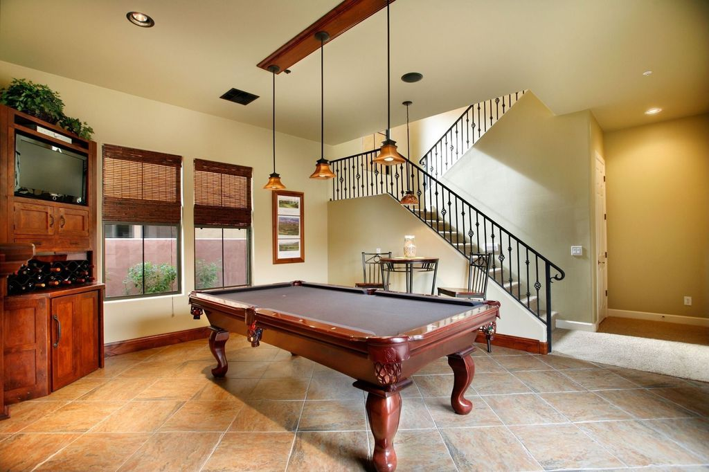Craftsman Game Room with Pendant light, picture window, High ceiling, Carpet, Concrete tile , can lights
