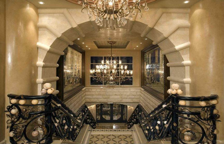 Mediterranean Staircase with curved staircase, Cathedral ceiling, Glass panel door, can lights, Chandelier, Carpet