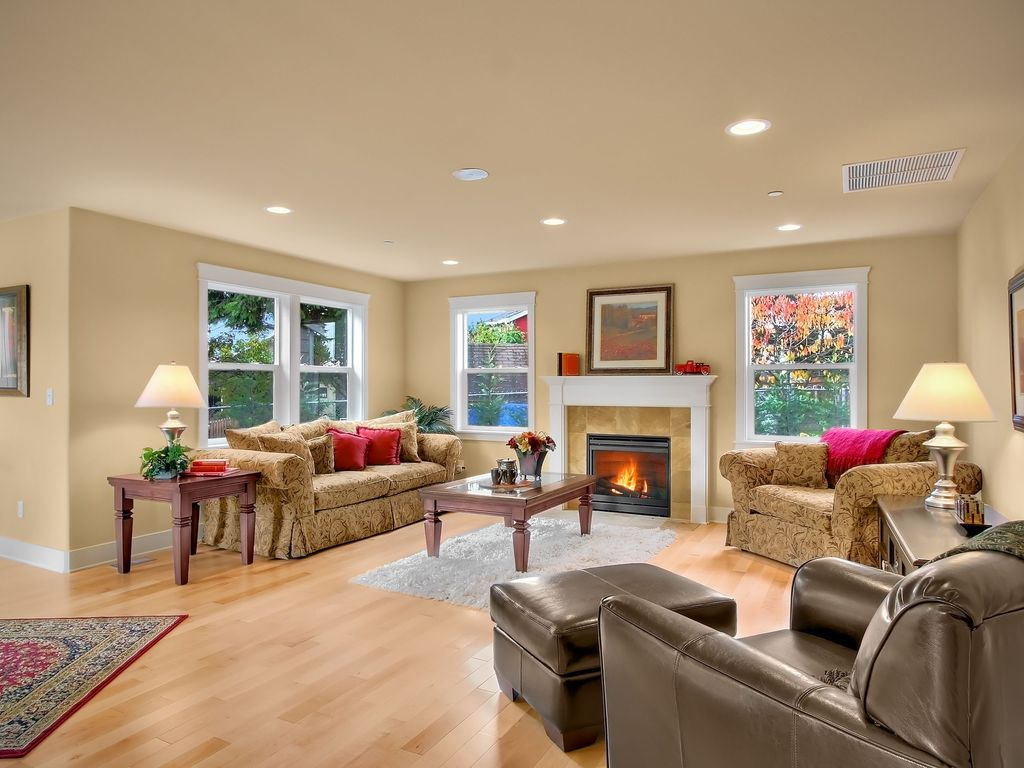 Traditional Living Room with Standard height, Hardwood floors, double-hung window, can lights, Fireplace, insert fireplace
