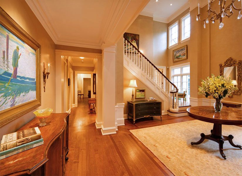 Traditional Entryway with flat door, Paint, Standard height, Hardwood floors, flush light, Paint 2, Built-in bookshelf