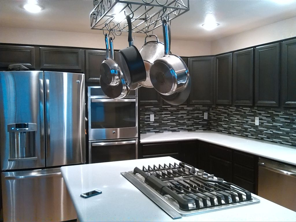 Contemporary Kitchen with flush light, dishwasher, Corian counters, L-shaped, Kitchen island, Standard height, Raised panel