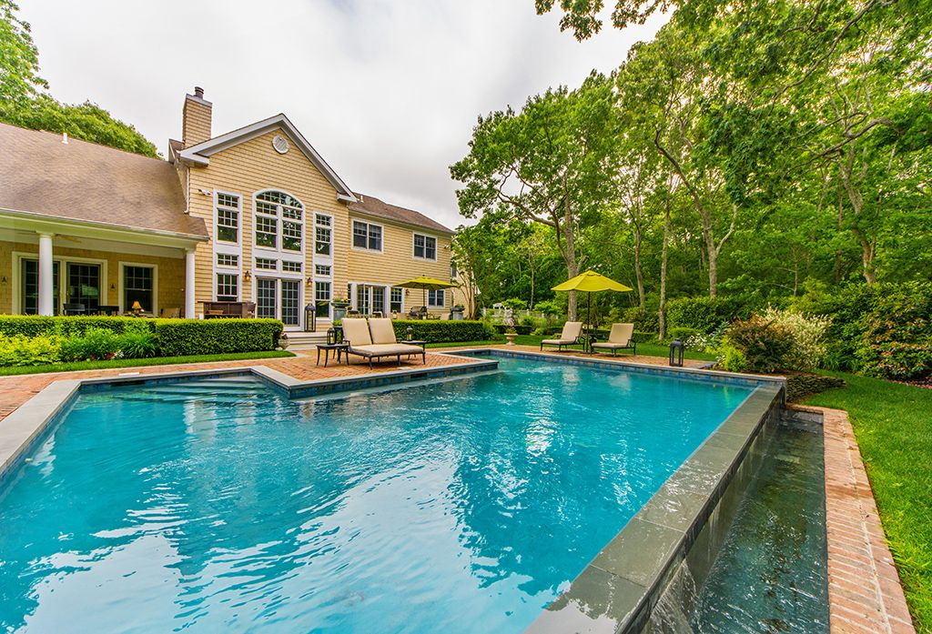 Contemporary Swimming Pool with Raised beds, Fence, Arched window, Infinity pool, French doors, Pathway, Transom window