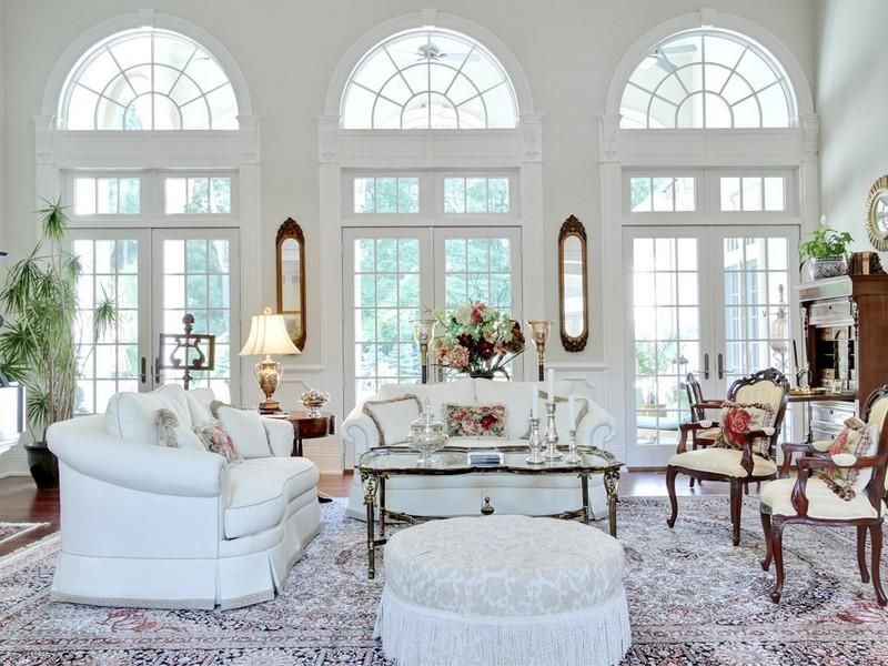 Traditional Living Room with High ceiling, Transom window, Hardwood floors, French doors, Arched window