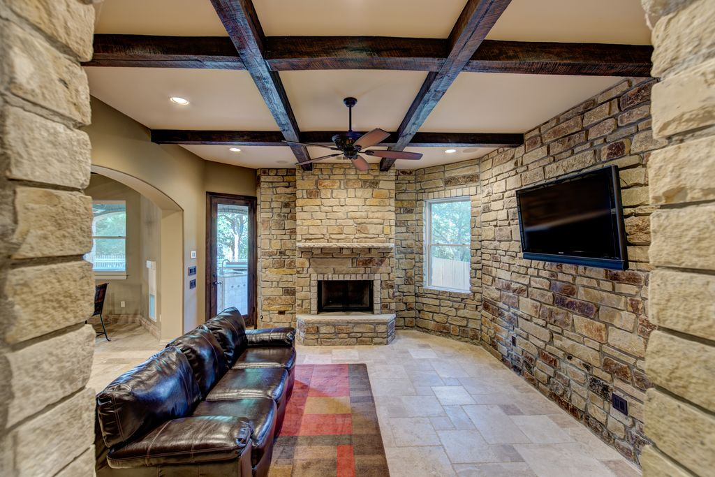 Rustic Living Room With Limestone Tile Floors Ceiling