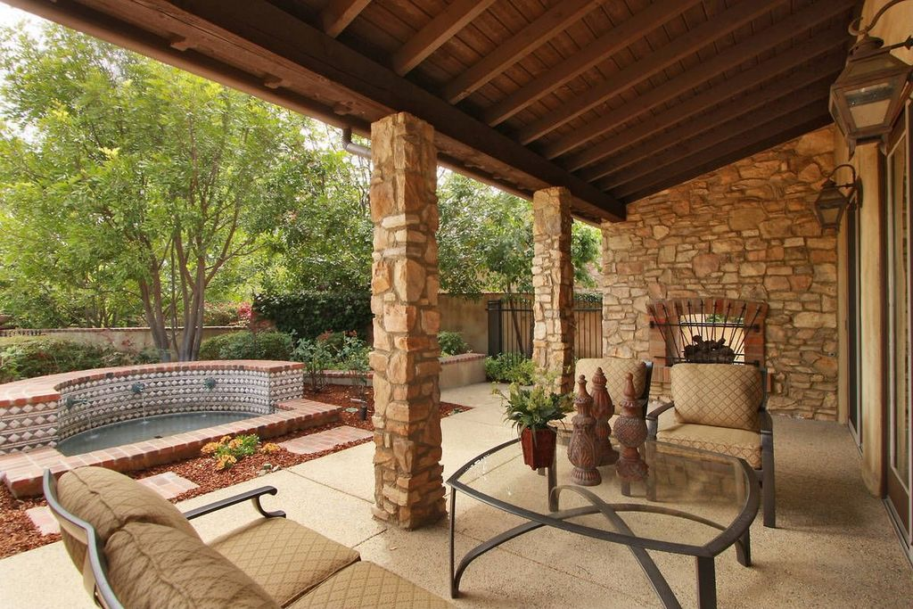 Mediterranean Patio with Gate, exterior stone floors, Fence, French doors