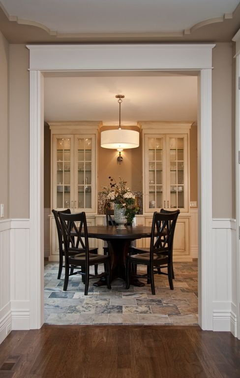 Traditional Dining Room with quartz floors, Keaton Side Chair, Chair rail, Wainscotting, Kichler Brushed Nickel Pendant