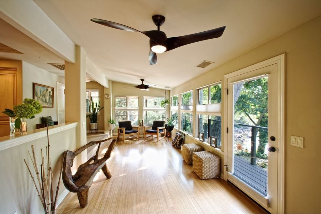 Contemporary Living Room with French doors, Standard height, double-hung window, Columns, Ceiling fan, Bamboo floors