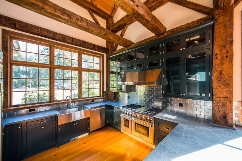 Rustic Kitchen with Wall Hood, Hardwood floors, Standard height, Exposed beam, U-shaped, Glass panel, Farmhouse sink