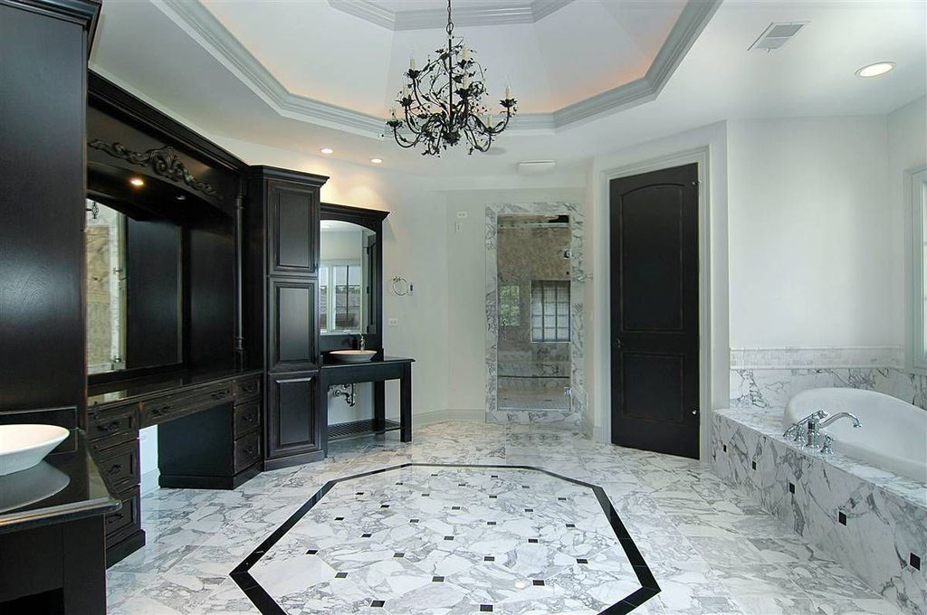 Traditional Master Bathroom with specialty door, complex marble floors, High ceiling, Master bathroom, Chandelier