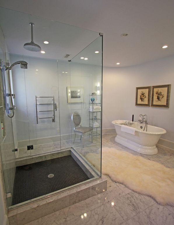 Contemporary Master Bathroom with Towel warmer, Shower, Handheld showerhead, Rain shower, Master bathroom, can lights