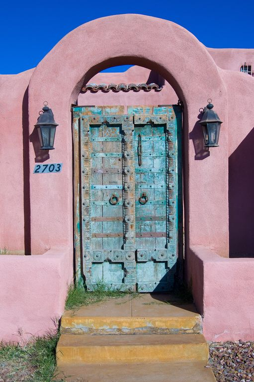 Eclectic Front Door with exterior concrete tile floors, Raised beds, Pathway, Saloon door, Fence, Gate, exterior tile floors