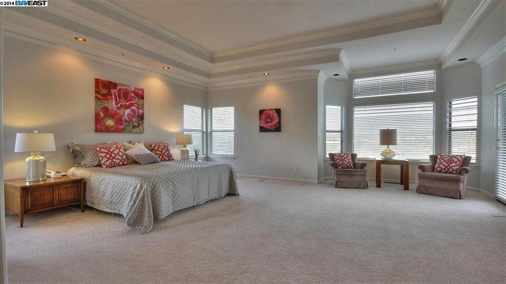 Traditional Master Bedroom with can lights, French doors, double-hung window, Carpet, picture window, Standard height