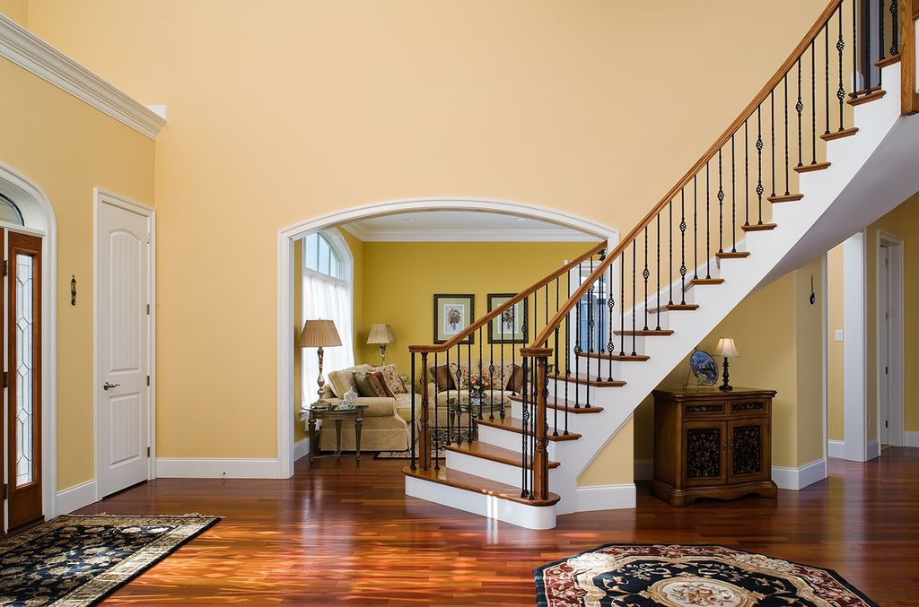 Traditional Entryway with French doors, High ceiling, specialty door, Transom window, Crown molding, Hardwood floors
