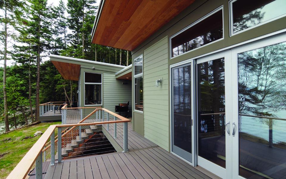 Contemporary Deck with Transom window, French doors, Deck Railing