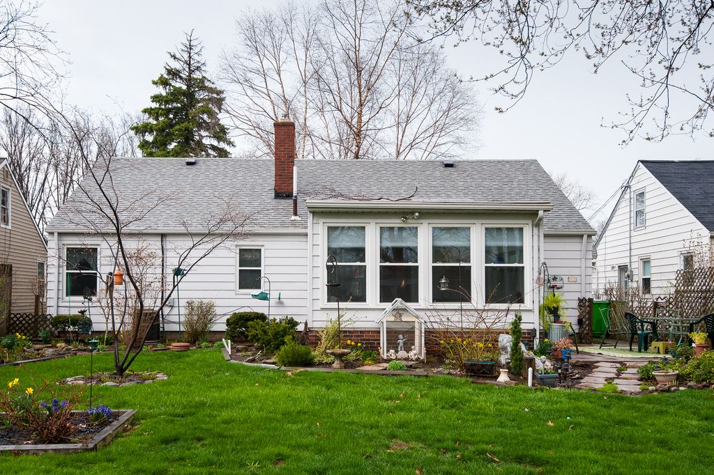 Backyard of suburban home with several windows