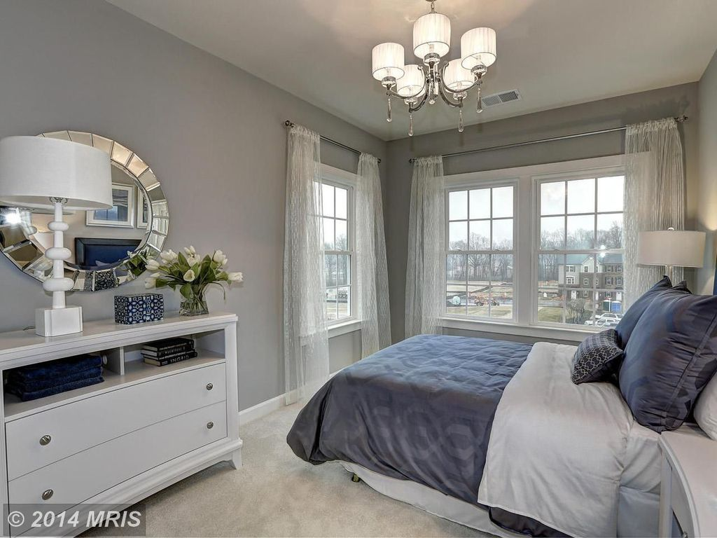 Traditional Guest Bedroom with double-hung window, Chandelier, Standard height, Carpet