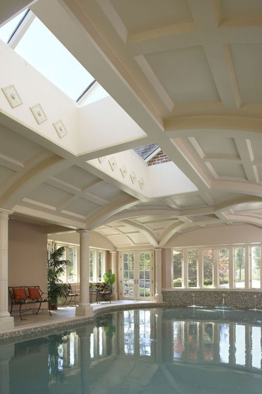 Traditional Swimming Pool with Skylight, exterior stone floors, picture window, Indoor pool, French doors