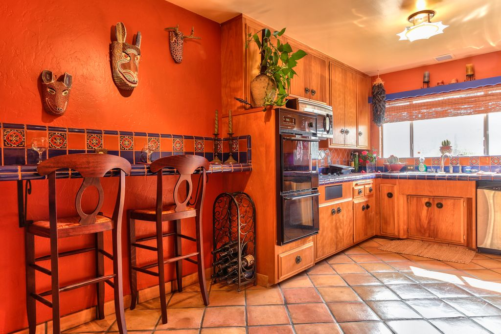 Kitchen with terracotta tile floors l shaped in long for Southwestern kitchen designs