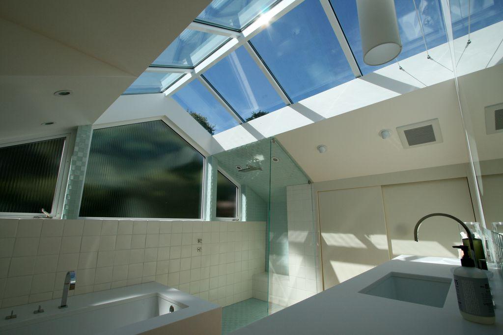Modern Master Bathroom with Wall Tiles, Bathtub, Master bathroom, Rain shower, Corian counters, Undermount sink, High ceiling