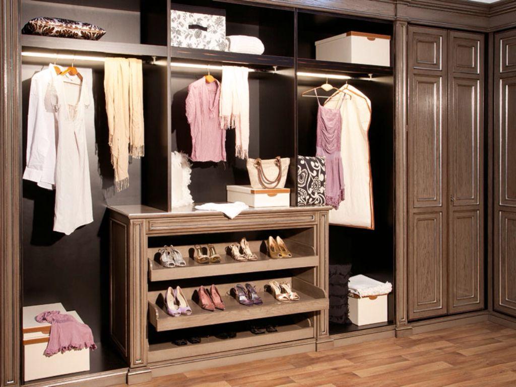 Traditional Closet with Hardwood floors, Standard height, Built-in bookshelf, Crown molding