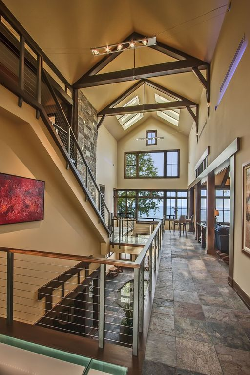 Rustic Hallway with picture window, can lights, Exposed beam, Cathedral ceiling, slate floors, Casement, Skylight