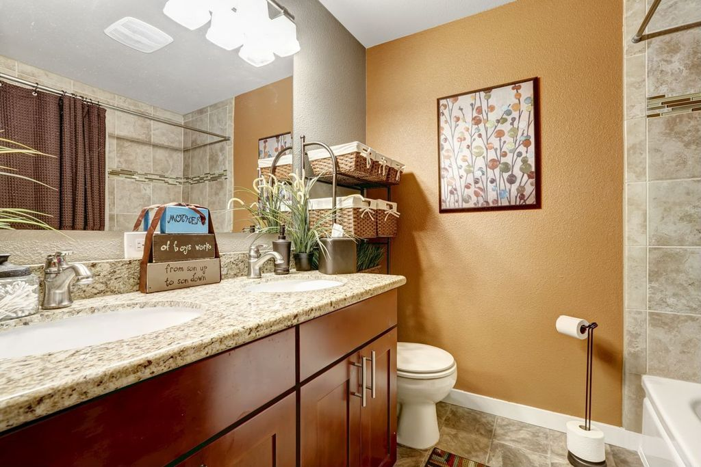 Contemporary Full Bathroom with stone tile floors, shower bath combo, drop in bathtub, Complex Granite, Flat panel cabinets