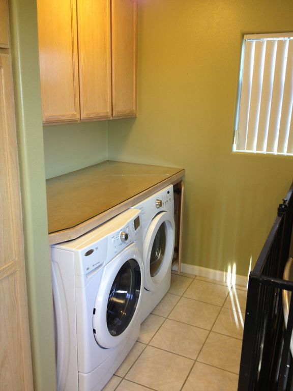 Traditional Laundry Room with drop-in sink, Standard height, limestone floors, Built-in bookshelf, laundry sink