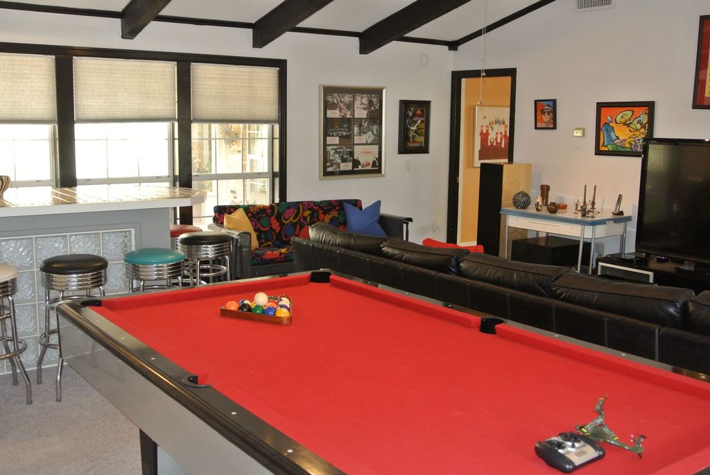 Traditional Game Room with Carpet, Exposed beam