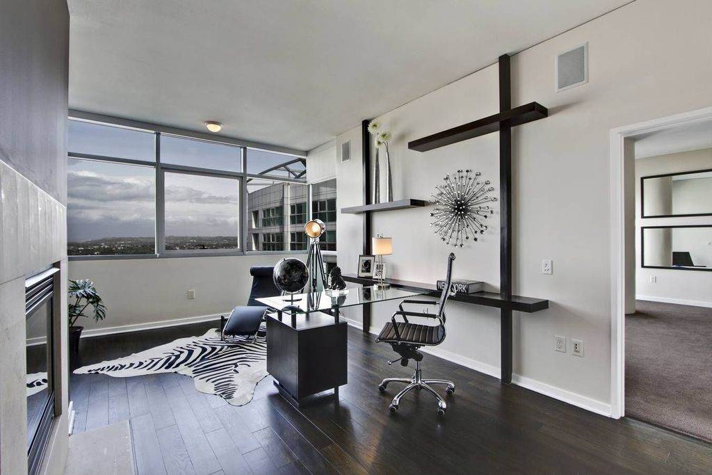 Contemporary Home Office with Standard height, flush light, Hardwood floors, insert fireplace, Fireplace, picture window