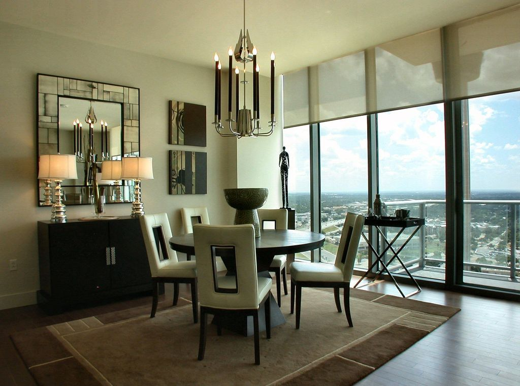 Contemporary Dining Room with Standard height, Hardwood floors, sliding glass door, French doors, Carpet, Casement