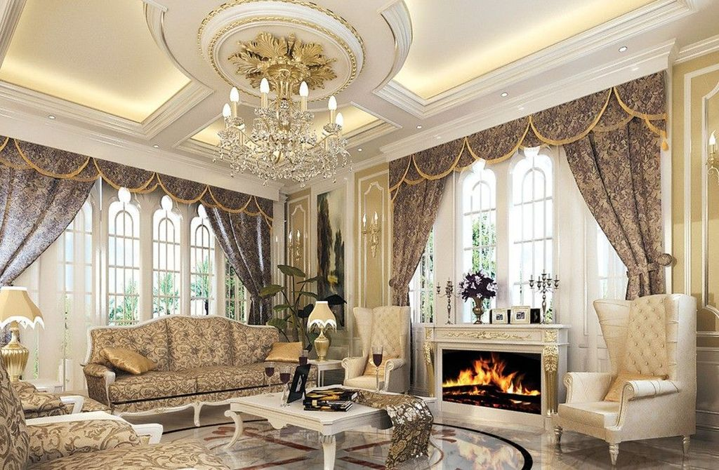 Traditional Living Room with Arched window, Standard height, can lights, picture window, Fireplace, Crown molding, Chandelier