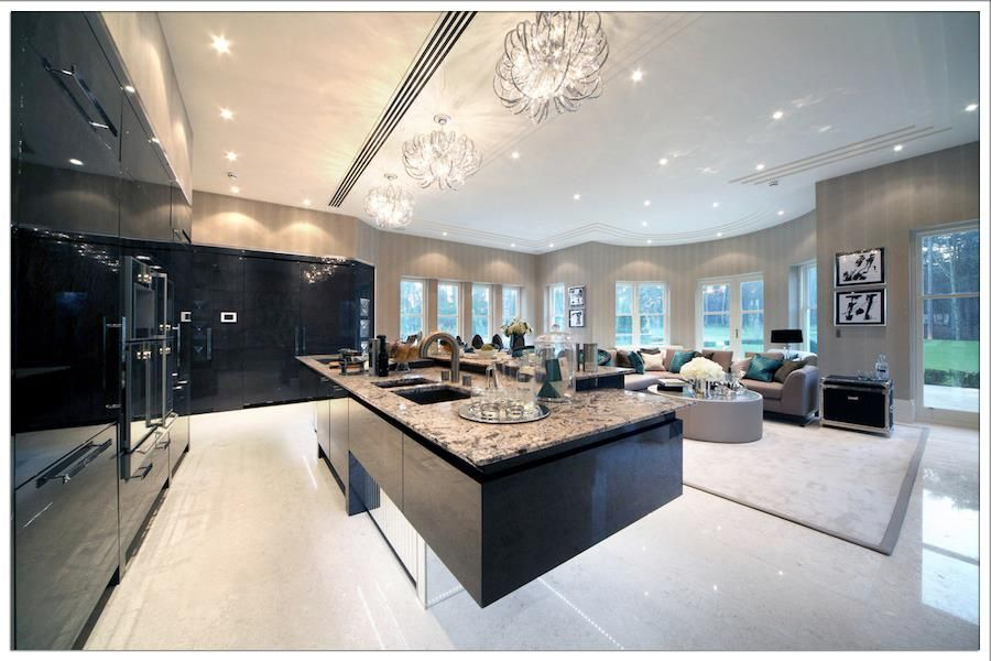 Contemporary Kitchen with Flush, L-shaped, European Cabinets, double wall oven, Built In Panel Ready Refrigerator, can lights