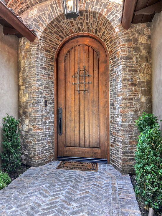 Traditional Front Door with Pathway, exterior brick floors, Arched door, Barn door