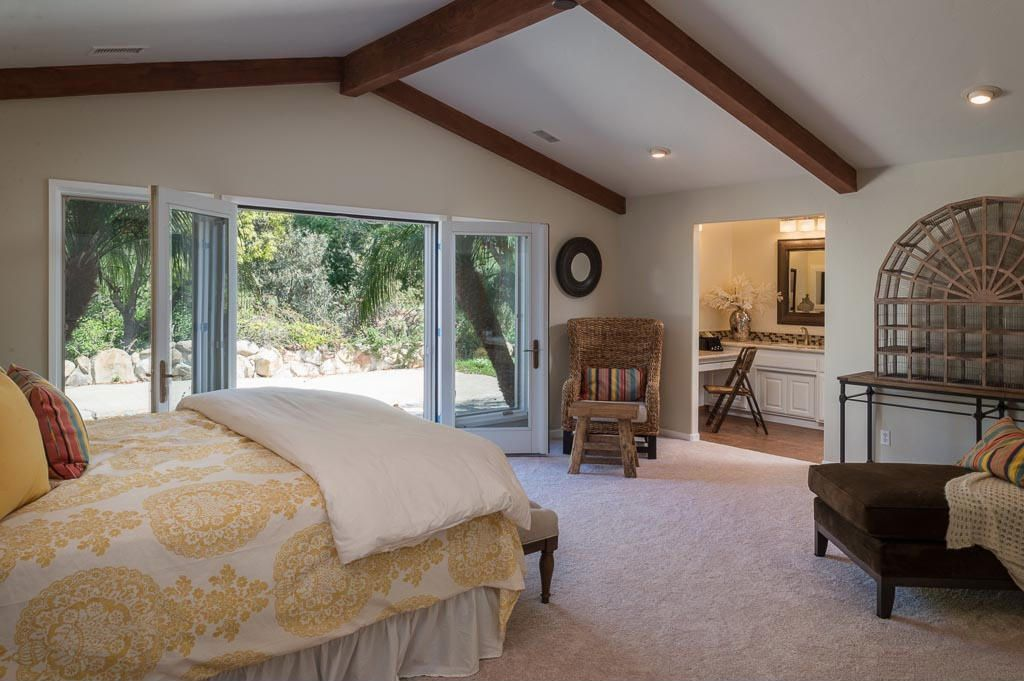 Rustic Master Bedroom with French doors, can lights, Exposed beam, Standard height, Carpet
