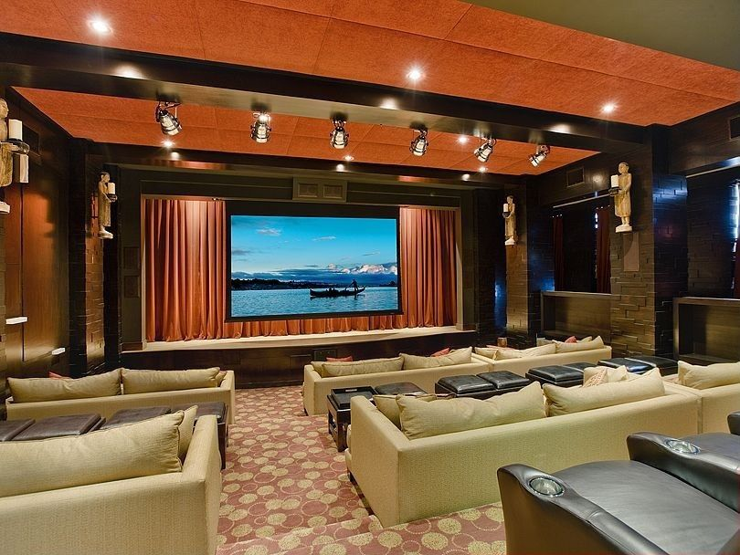 Contemporary Home Theater with can lights, High ceiling, Concrete floors