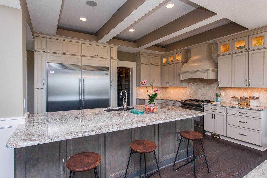Contemporary Kitchen with Exposed beam, Hardwood floors, Built-in ...