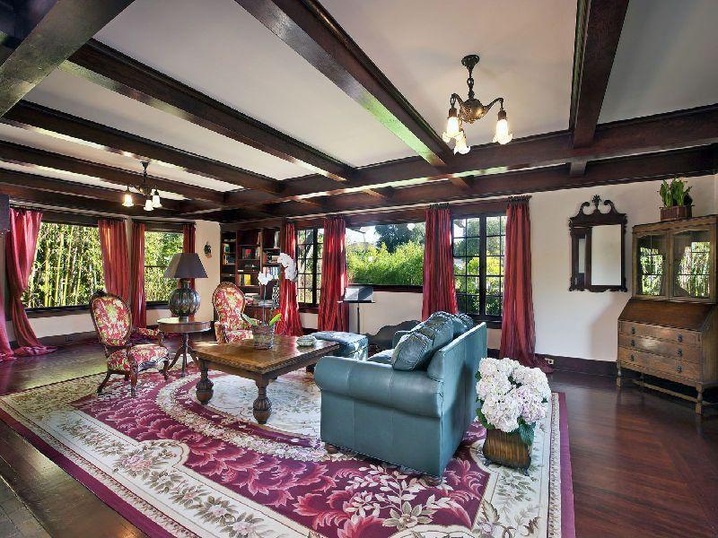 Craftsman Living Room with picture window, Hardwood floors, double-hung window, Built-in bookshelf, Exposed beam, Chandelier