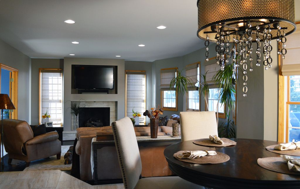 Contemporary Great Room with Chandelier, slate floors, Fireplace, Standard height, Cement fireplace, can lights