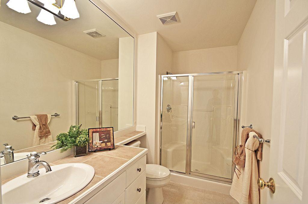 Traditional Full Bathroom with limestone tile floors, Standard height, framed showerdoor, Flush, stone tile floors, Shower