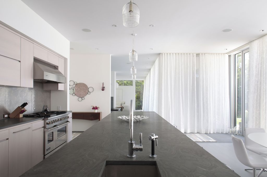 Contemporary Kitchen with Standard height, Simple granite counters, sliding glass door, full backsplash, Pendant light, Flush