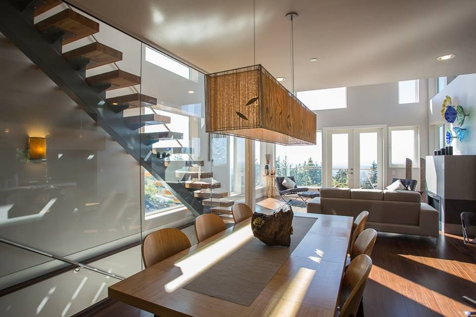 Contemporary Dining Room with picture window, Pendant light, can lights, Hardwood floors, Standard height