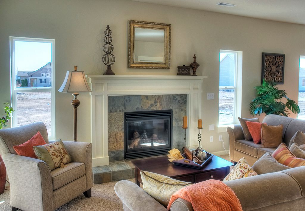 Traditional Living Room with Paint, Standard height, Dark mix slate ceramic floor tile, other fireplace, Fireplace, Carpet