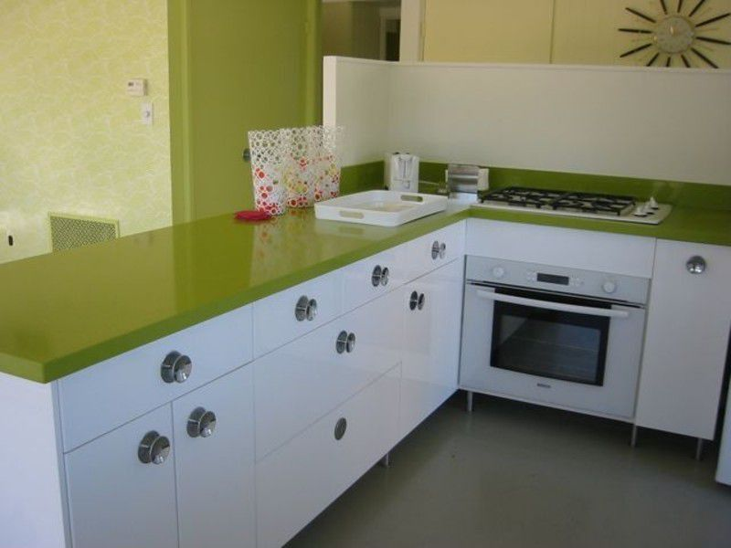 Contemporary Kitchen with Paint 1, wall oven, Concrete floors, Standard height, Flush, interior wallpaper, European Cabinets