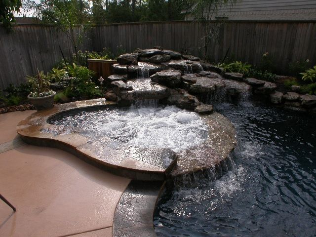 Mediterranean Hot Tub with Fence, Water feature, Concrete floors, Pool with hot tub, Pool waterfall feature