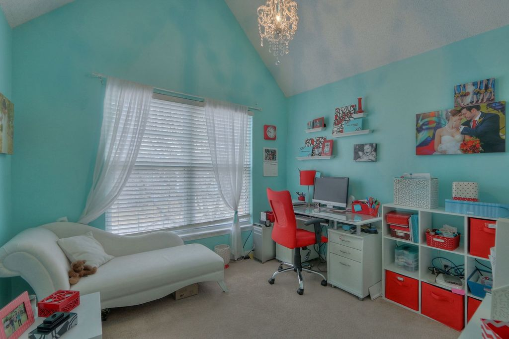 Eclectic Home Office with double-hung window, Carpet, Built-in bookshelf, Chandelier, High ceiling