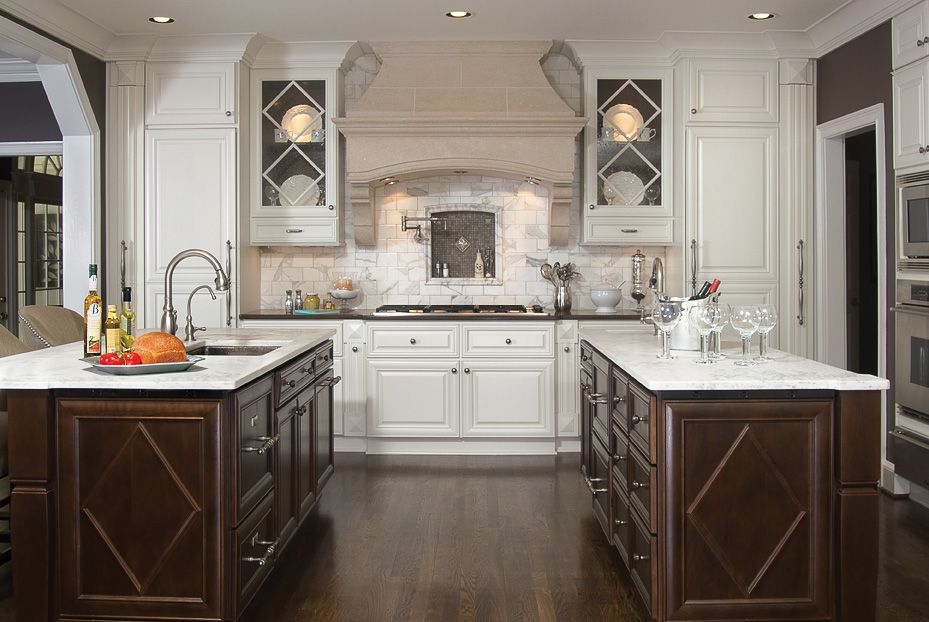 Traditional Kitchen with electric cooktop, Glass panel, Custom hood, Simple marble counters, Flat panel cabinets, L-shaped