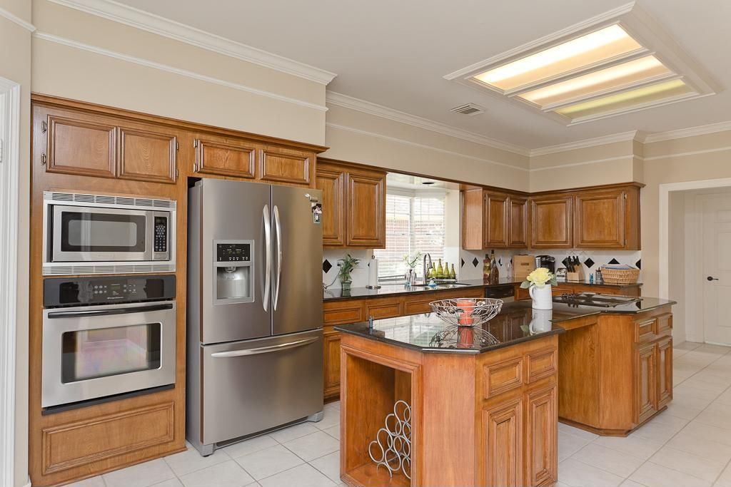 Traditional Kitchen with L-shaped, flush light, Soapstone counters, Large Ceramic Tile, Kitchen island, Inset cabinets